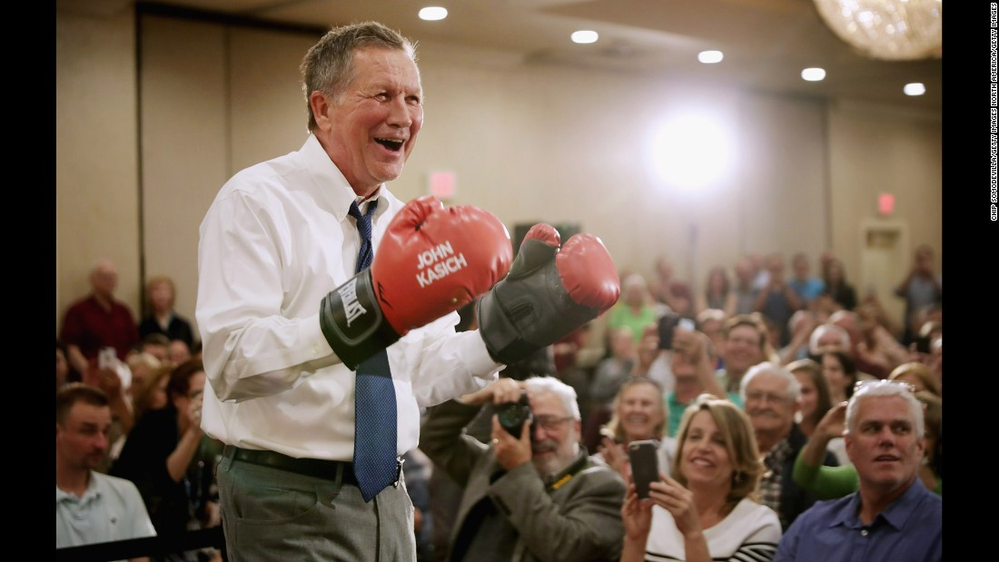 Republican presidential candidate John Kasich puts on a pair of boxing gloves given to him by a supporter during a campaign town hall meeting in the ballroom at a Crowne Plaza hotel on Tuesday, April 19, in Annapolis, Maryland.