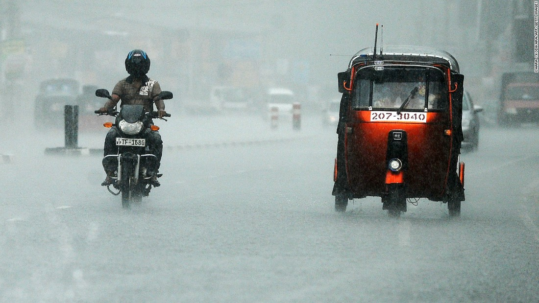 Commuters drive through heavy rain in Colombo, Sri Lanka, on Tuesday, April 19.