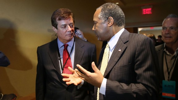 Donald Trump's political strategist Paul Manafort (L) speaks with former Republican presidential candidate Ben Carson as they arrive for a Trump for President reception with guests during the Republican National Committee Spring meeting at the Diplomat Resort on April 21 2016 in Hollywood, Florida.