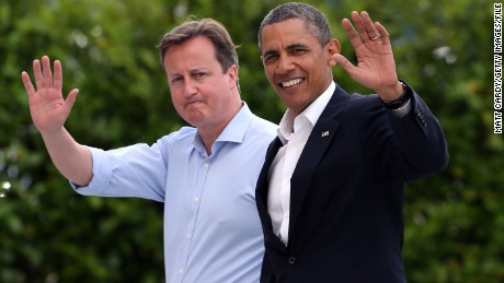 ENNISKILLEN, NORTHERN IRELAND - JUNE 17:  Britain's Prime Minister David Cameron (L) and US President Barack Obama (R) wave as they arrive at the G8 venue of Lough Erne on June 17, 2013 in Enniskillen, Northern Ireland. The two day G8 summit, hosted by UK Prime Minister David Cameron, is being held in Northern Ireland for the first time. Leaders from the G8 nations have gathered to discuss numerous topics with the situation in Syria expected to dominate the talks.  (Photo by Matt Cardy/Getty Images)