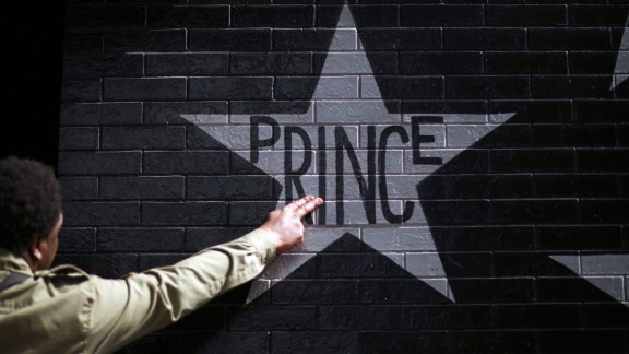 After kissing his fingers, a fan touches Prince
