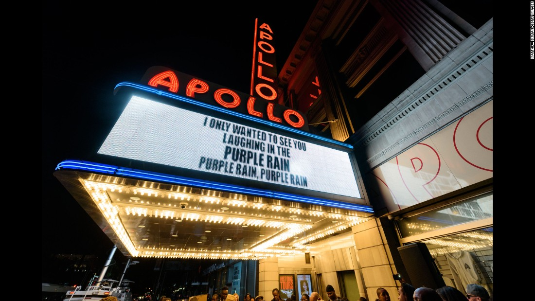 People gather outside the Apollo Theater in New York to mourn and celebrate the life of Prince on April 21.