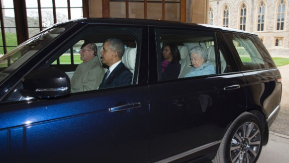 Philip drives the President, the first lady and Elizabeth from the helicopter into Windsor Castle after the Obama