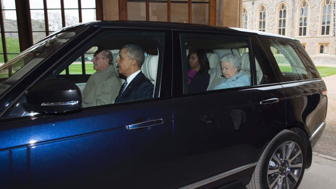 Philip drives the President, the first lady and Elizabeth from the helicopter into Windsor Castle after the Obama's arrived for a private lunch in Windsor, England, on April 22, 2016.