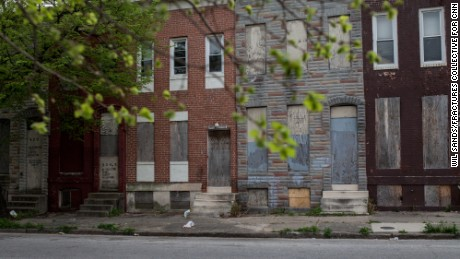 Baltimore has an estimated 18,000 vacant buildings. The city, built for a million people, now has about 600,000 residents, and many homeowners have  died or moved away. The city has a new program to demolish vacant homes.
