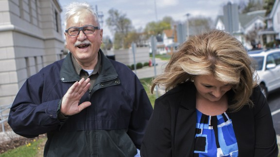 Jack McCullough walks out of the DeKalb County Courthouse in Sycamore, Illinois, with Crystal Harrolle, an investigator with the public defender