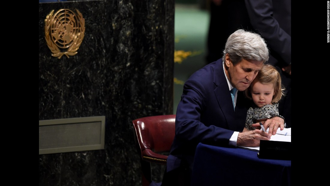 "U.S. Secretary of State John Kerry at the <a href=""http://www.cnn.com/2016/04/22/opinions/sutter-un-earth-day/index.html"" target=""_blank"">signature ceremony for the Paris Agreement at the United Nations General Assembly Hall </a>on Friday, April 22.  Leaders from at least 175 countries came to New York to sign the international treaty that aims to limit global warming to well below 2 degrees Celsius.  Kerry is holding his granddaughter, Isabelle Dobbs-Higginson."