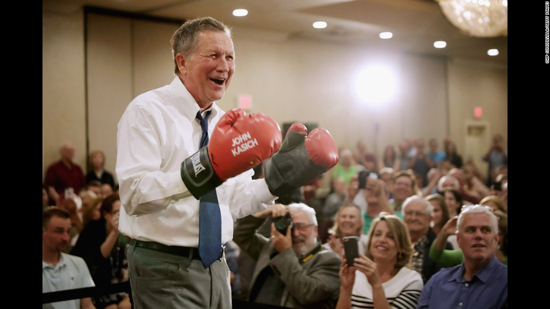 Republican presidential candidate Gov. John Kasich puts on a pair of boxing gloves given to him by a supporter during a campaign town hall meeting on Tuesday, April 19, in Maryland.