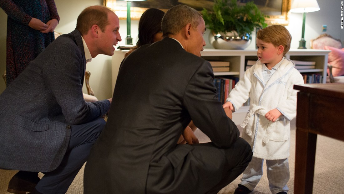 President Barack Obama, Prince William and first lady Michelle Obama talk with Prince George at Kensington Palace on April 22, 2016, in London.