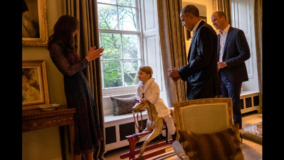 US President Barack Obama talks with Prince William as Catherine plays with Prince George in April 2016. The President and his wife were visiting Kensington Palace.