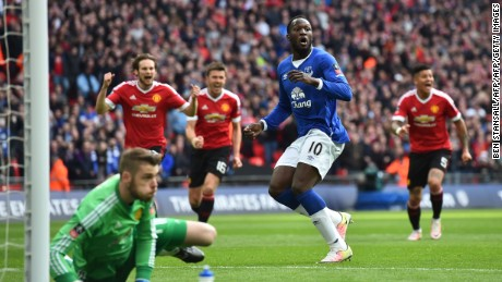 Everton's striker Romelu Lukaku (C) reacts after Manchester United goalkeeper David de Gea (L) saved his penalty kick during the English FA Cup semi-final.