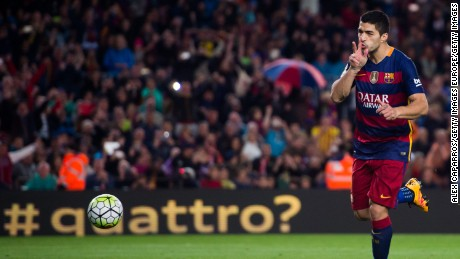 Luis Suarez celebrates after scoring Barcelona's fourth goal against Sporting Gijon.