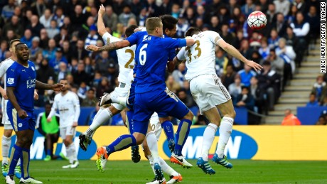 Leonardo Ulloa heads Leicester's second goal just before halftime in the 4-0 win over Swansea City.