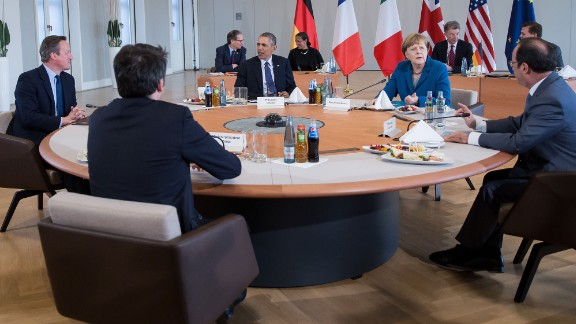 From left, British Prime Minister David Cameron, Italian Prime Minister Matteo Renzi, U.S. President Barack Obama, German Chancellor Angela Merkel and French President Francois Hollande sit together at Herrenhausen Palace in Hanover, Germany, on Monday, April 25. Germany was the third stop on Obama
