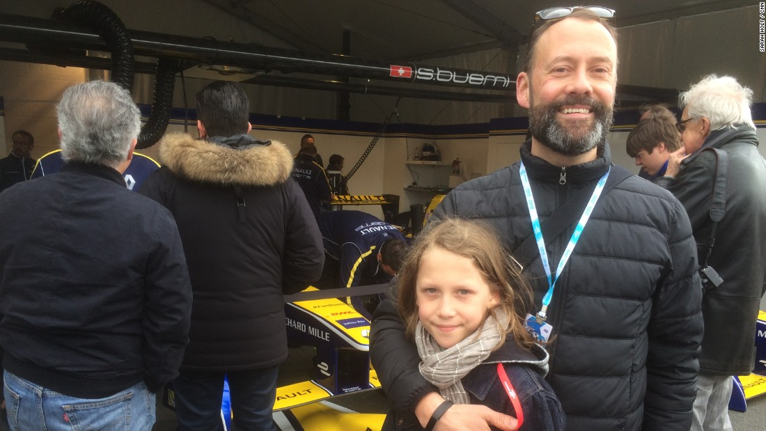 """Formula E is what got me into cars,"" explains Milo from London, who is seen outside the garage of his favorite driver, Sebastien Buemi, in Paris. Dad Hector says his son discovered Formula E by watching online."