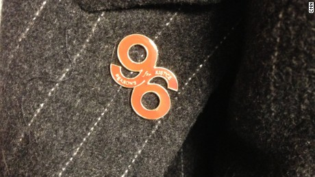"""96 reasons for justice"" -- A lapel pin commemorates the lives lost, while calling for an inquiry."