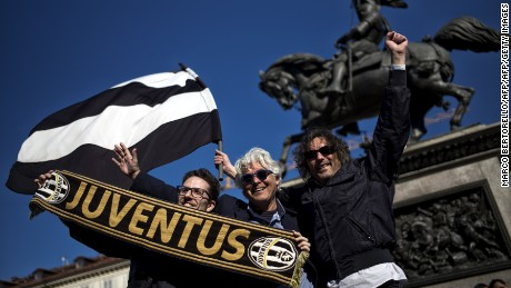 "Juventus supporters celebrate in Turin after the club's latest ""Scudetto"" triumph."