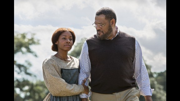 """The rebooted miniseries """"Roots"""" debuted Monday with Anika Noni Rose, who plays Kizzy, and Laurence Fishburne as Alex Haley."""