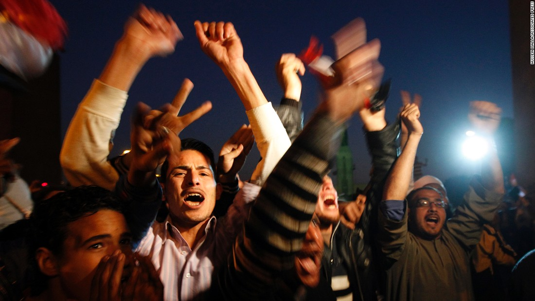 Egyptians celebrate in Cairo's Tahrir Square after Mubarak steps down in February 2011.