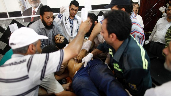 An injured man is carried into a makeshift hospital after clashes between Egyptian police and Morsy supporters in July 2013. Morsy was ousted in a military coup after a year in office.