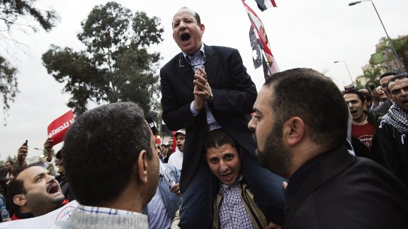 A man shouts political slogans during a march to the presidential palace in Cairo in December 2012.