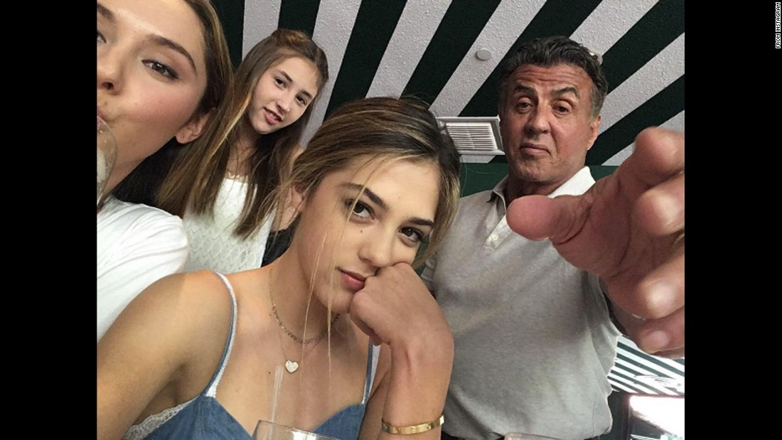 """Trying to get my phone back,"" <a href=""https://www.instagram.com/p/BECvBfUxxRJ/"" target=""_blank"">actor Sylvester Stallone said on Instagram</a> on Sunday, April 10. He is surrounded by his daughters Sophia, Scarlet and Sistine."