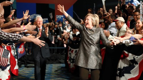 Democratic presidential candidate Hillary Clinton accompanied by former President Bill Clinton walks to stage at her presidential primary election night rally, Tuesday, April 26, in Philadelphia.