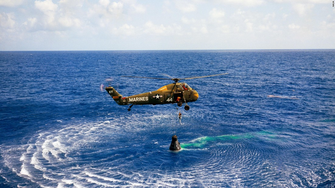A helicopter picks up Shepard after his capsule landed in the Atlantic Ocean. Engineers said the spacecraft was in such great shape that it could be reused.