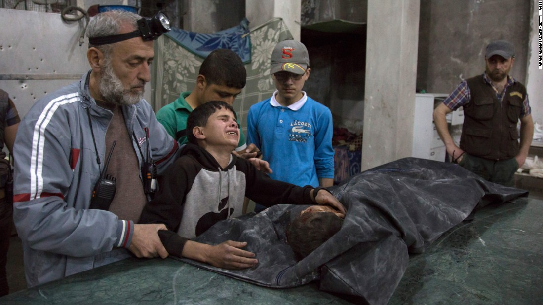 "A boy is comforted as he cries next to the body of a relative who died in a reported airstrike in Aleppo, Syria, on Wednesday, April 27. <a href=""http://www.cnn.com/2016/04/28/middleeast/syria-aleppo-hospital-airstrike/index.html"" target=""_blank"">At least 148 civilians have been killed in Aleppo</a> over a six-day period, according to the Syrian Observatory for Human Rights. <a href=""http://www.cnn.com/2015/05/22/world/gallery/syria-civil-war-pictures/index.html"" target=""_blank"">Syria's civil war in pictures</a>"