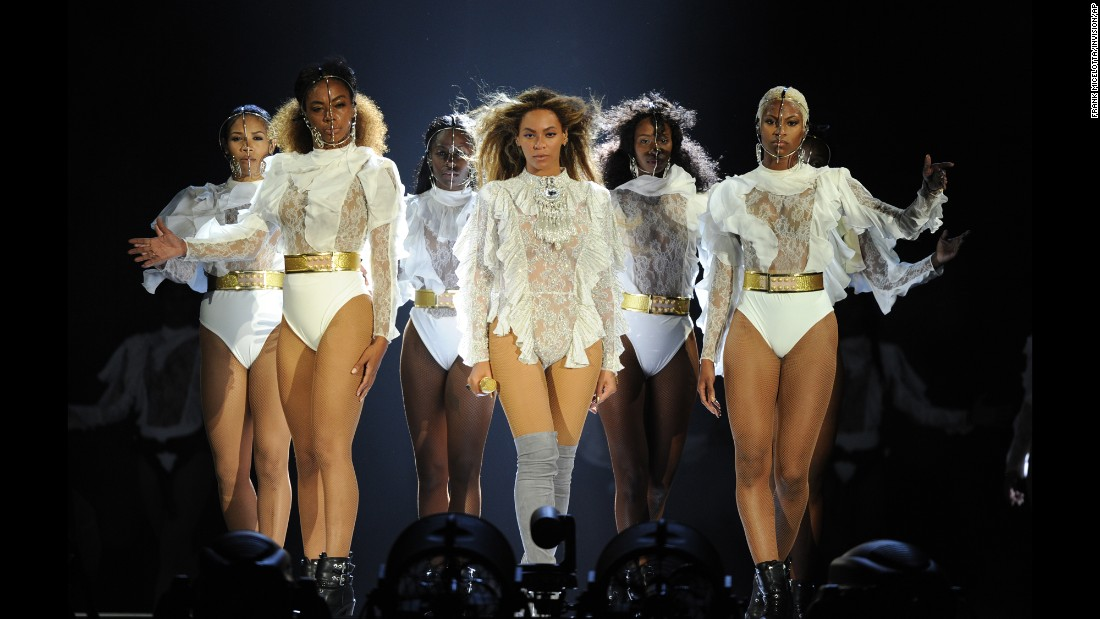"Beyonce, center, performs in Miami during the first stop of her ""Formation World Tour"" on Wednesday, April 27. The singer's fans <a href=""http://www.cnn.com/2016/04/23/entertainment/beyonce-lemonade-hbo/"" target=""_blank"">are still dissecting</a> her new visual album, ""Lemonade,"" which premiered April 23 on HBO."