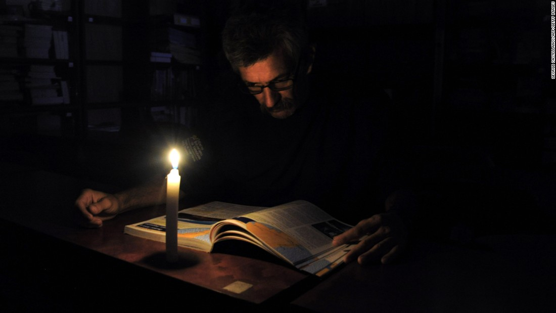 "A man reads by candlelight after power was cut in the Venezuelan state of San Cristobal on Monday, April 25. The country, dealing with a severe power shortage, has begun <a href=""http://www.cnn.com/2016/04/26/americas/venezuela-blackouts/"" target=""_blank"">40 days of rolling blackouts.</a>"
