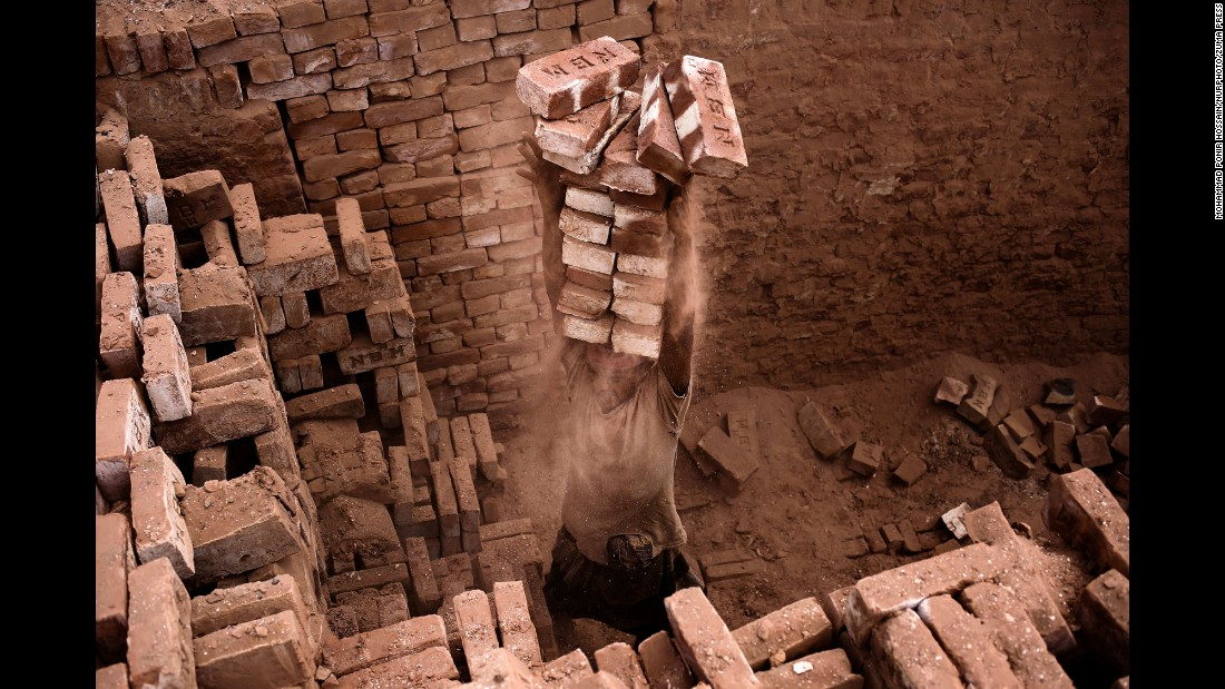 A laborer works in a brickyard in Dhaka, Bangladesh, on Monday, April 25.