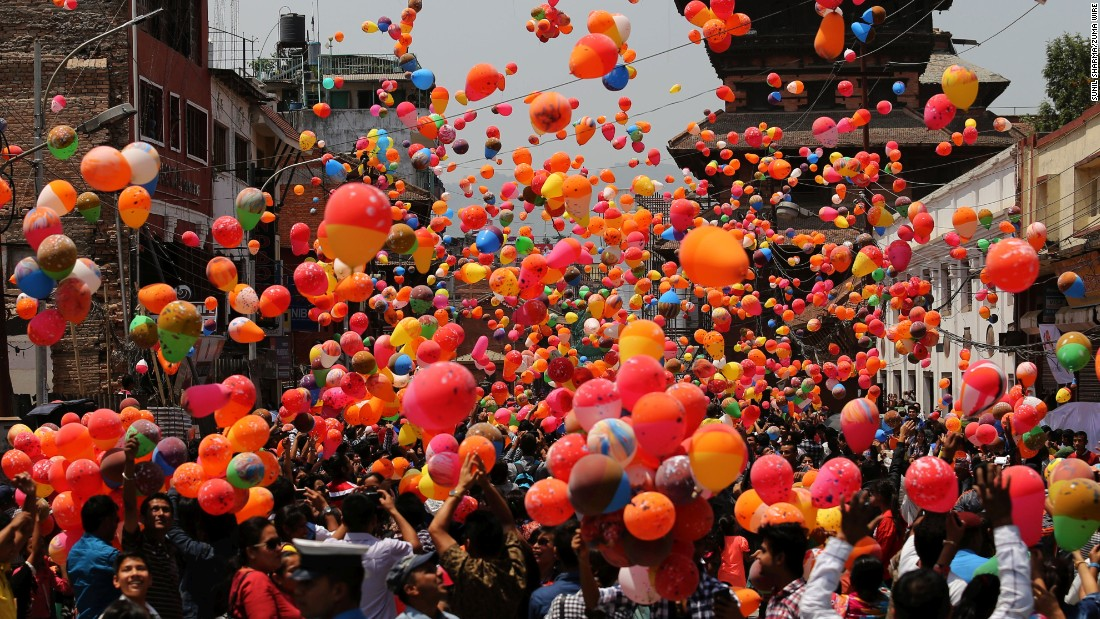 "People in Kathmandu, Nepal, release balloons Saturday, April 23, to remember the thousands of people who died in <a href=""http://www.cnn.com/specials/world/nepal-earthquake"" target=""_blank"">the country's earthquakes</a> last year."