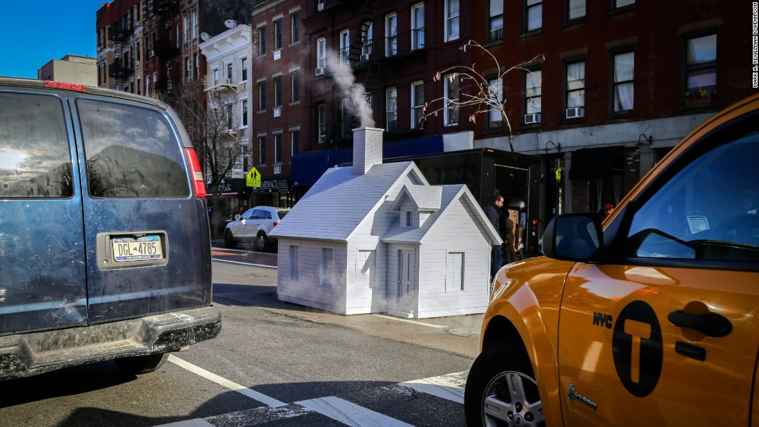"A tiny house, designed by artist Mark Reigelman II, covers a manhole in New York on Thursday, April 28. Reigelman <a href=""http://www.slate.com/blogs/the_eye/2016/04/27/smokers_by_mark_a_reigelman_ii_is_a_roving_tiny_house_on_the_streets_of.html"" target=""_blank"">created several of these</a> in the city."