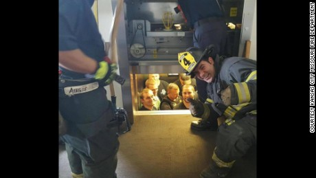 The Kansas City, Missouri Fire Department shared this image of police being rescued from an elevator.
