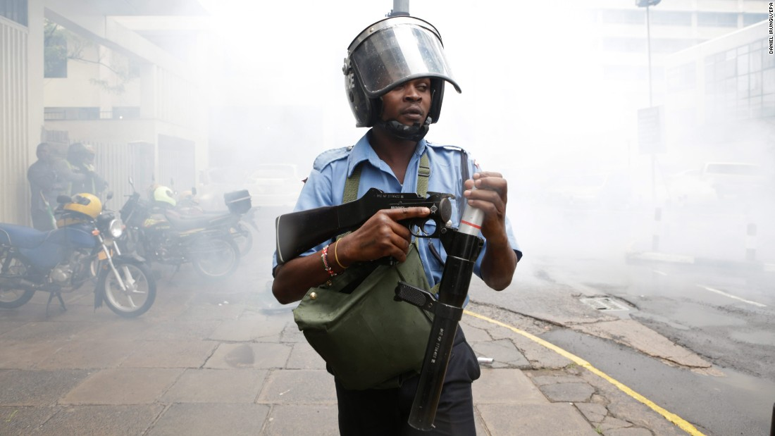 A police officer in Nairobi, Kenya, loads his teargas launcher to disperse opposition protesters on Monday, April 25.