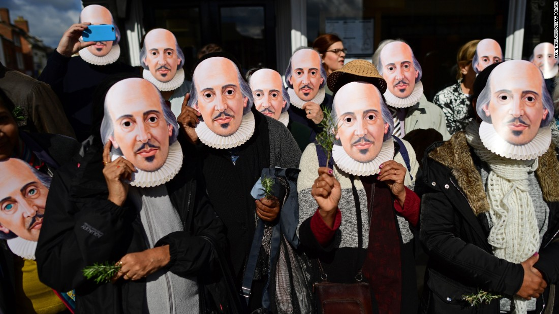 People wear William Shakespeare masks as they prepare for a parade in Stratford-upon-Avon, England, on Saturday, April 23. The famous poet died 400 years ago.