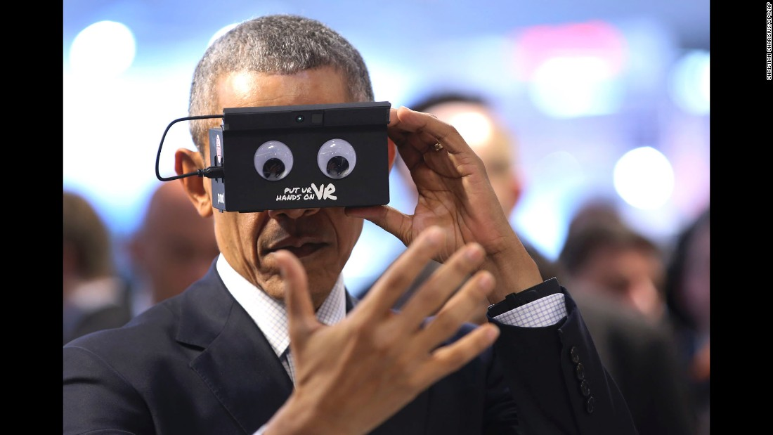 U.S. President Barack Obama tests virtual-reality goggles during a trade fair in Hannover, Germany, on Monday, April 25.