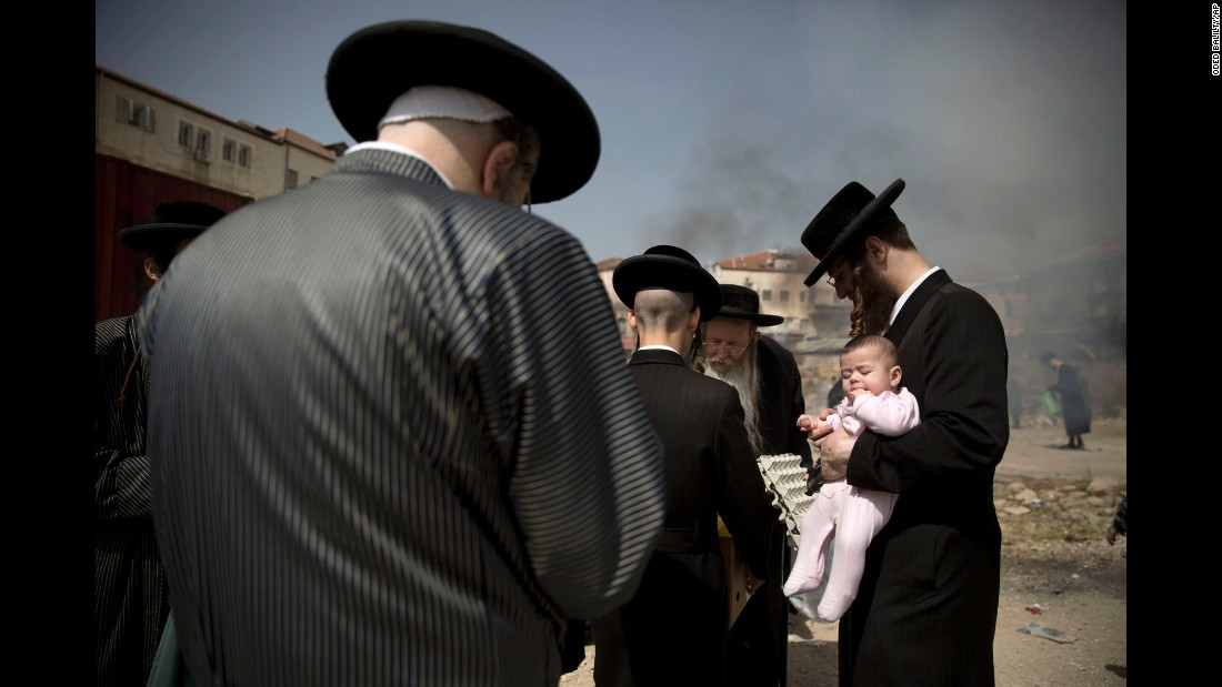 Ultra-Orthodox Jewish men burn leavened items in Jerusalem as they prepare for the Passover holiday on Friday, April 22.