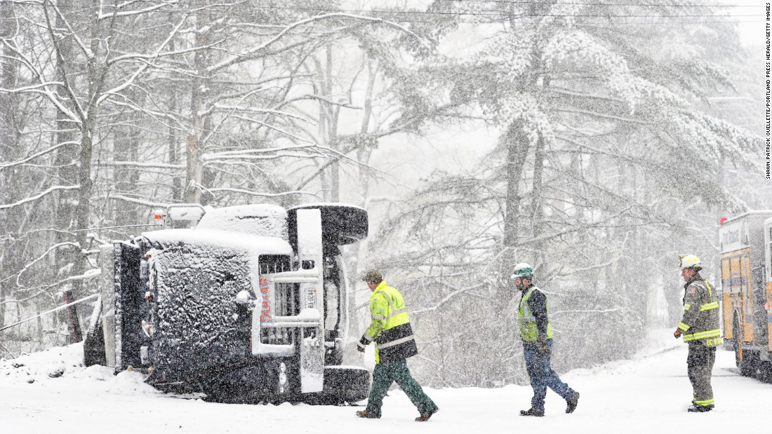 "Fire and rescue personnel look at the scene of an overturned truck in Freeport, Maine, on Tuesday, April 26. No one was hurt, according to the Portland Press Herald. <a href=""http://www.cnn.com/2016/04/19/weather/gallery/weather-in-focus/index.html"" target=""_blank"">Photo gallery: Weather in focus</a>"