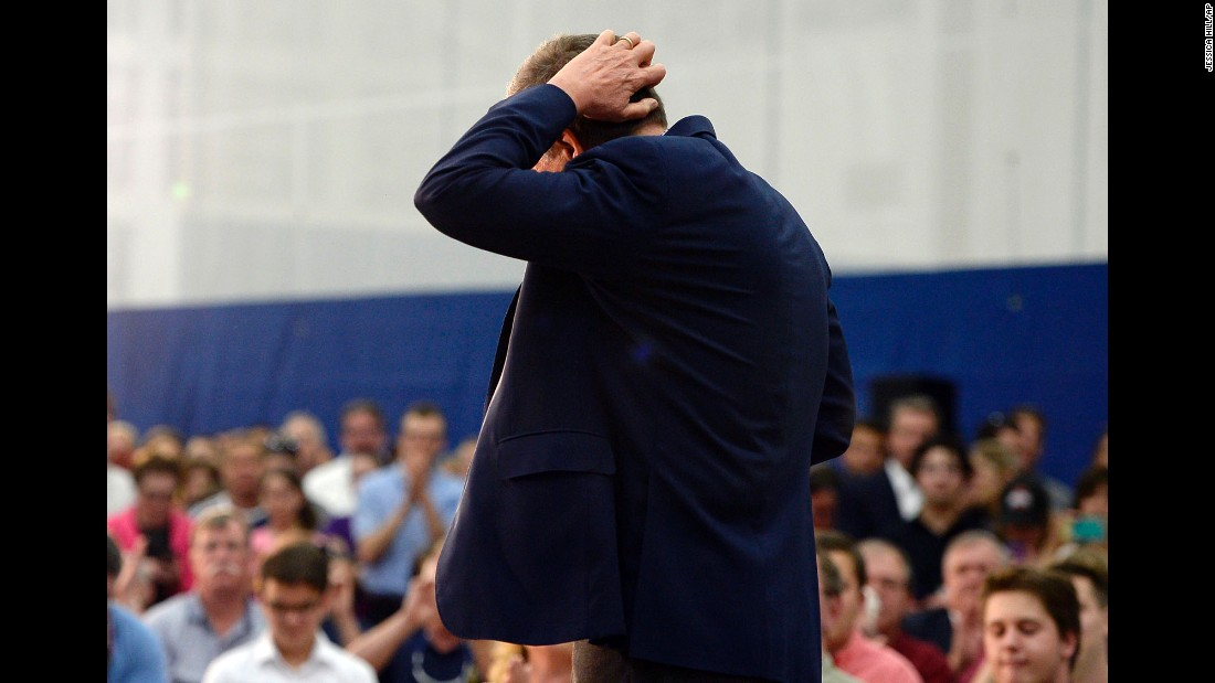 Ohio Gov. John Kasich, a Republican presidential candidate, scratches his head at a campaign event in Glastonbury, Connecticut, on Friday, April 22.