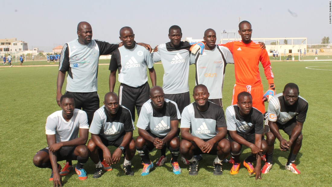 "The boys having a coaching team of 11 (pictured,) plus two on-site physiotherapists. ""Above all, we form men -- young Senegalese men -- so they can later become businessmen, ministers, presidents, and not exclusively football players,"" says head coach Moussa Kamara (second left, bottom row.) ""That's the big difference between Diambars and others."""
