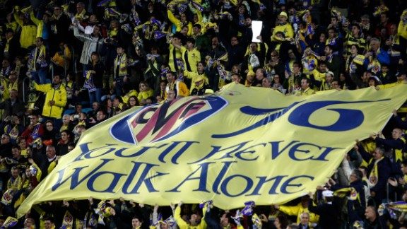 Villarreal supporters unfold a banner during the UEFA Europa League semifinal first leg football match Villarreal CF vs Liverpool FC at El Madrigal stadium in Vila-real on April 28, 2016. / AFP / BIEL ALINO        (Photo credit should read BIEL ALINO/AFP/Getty Images)
