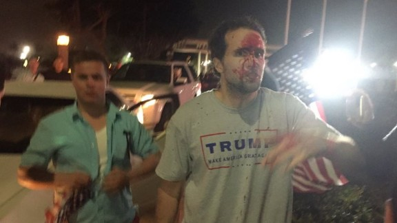 A Trump supporter was bloodied after an altercation during an anti-Trump protest in Costa Mesa, California.
