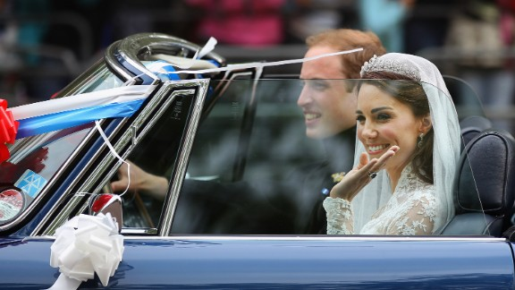 Prince William and Catherine, Duchess of Cambridge drive from Buckingham Palace in a decorated sports car on April 29, 2011 in London, England.