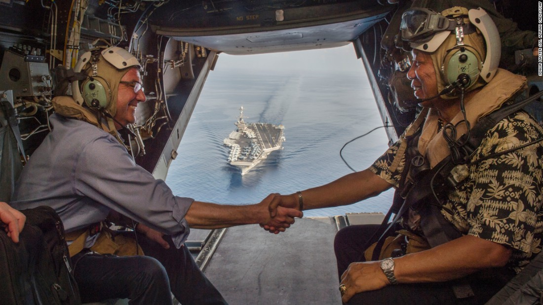 U.S. Secretary of Defense Ash Carter (left) and Philippine Secretary of National Defense Voltaire Gazmin shake hands on a Marine Corps V-22 Osprey as they depart the the aircraft carrier USS John C. Stennis (CVN 74) after touring the aircraft carrier as it sailed in the South China Sea on April 15, 2016.