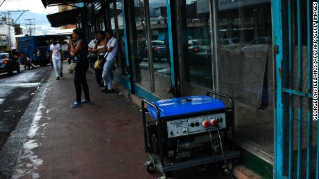 A power generator remains outside stores in the border state of San Cristobal, Venezuela, 600 km west of Caracas on April 25, 2016. Recession-hit Venezuela will turn off the electricity supply in its 10 most populous states for four hours a day for 40 days to deal with a severe power shortage, the government said Thursday. / AFP / GEORGE CASTELLANOS        (Photo credit should read GEORGE CASTELLANOS/AFP/Getty Images)