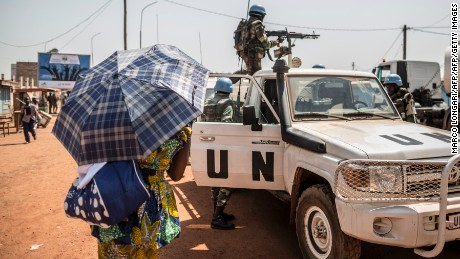 "Senegalese soldiers from MINUSCA (United Nations Mission in Central African Republic) patrol in the area where sporadic gunfire and improvised barricades closed the access to some district of Bangui on December 10, 2015.  Gunfire erupted on December 8, 2015 in the Central African Republic's capital Bangui, where protesters erected barricades after an announcement that ex-president Francois Bozize was barred from running for election. A French embassy text message sent to citizens said there were ""barricades and gunfire"" in several districts and advised French citizens ""to avoid these areas"".   / AFP / MARCO LONGARI        (Photo credit should read MARCO LONGARI/AFP/Getty Images)"
