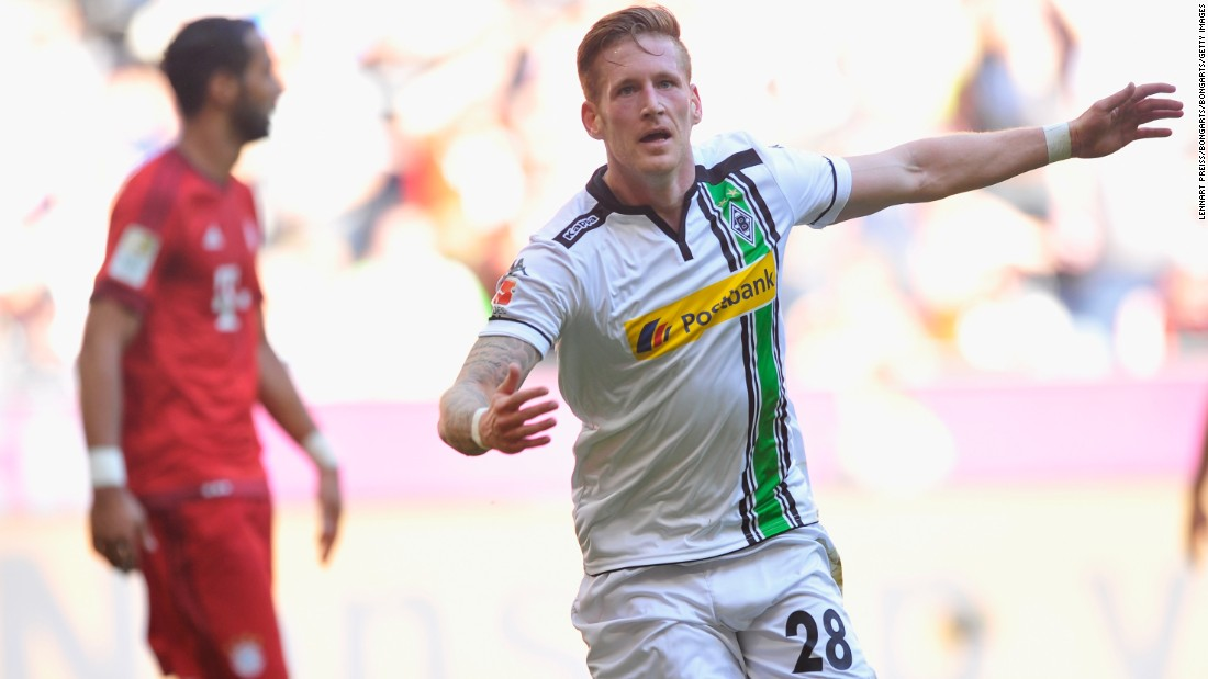 Andre Hahn of Borussia Moenchengladbach celebrates scoring his team's first goal during the Bundesliga match between Bayern Muenchen and Borussia Moenchengladbach at Allianz Arena.