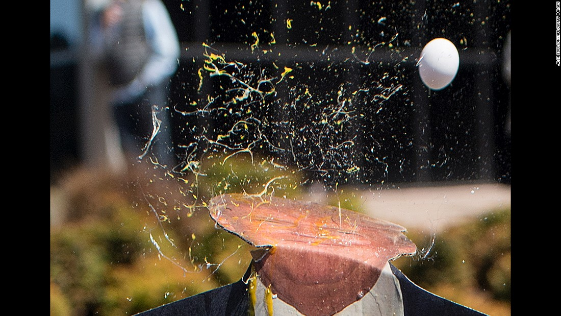 An egg is thrown at a cardboard cutout of Republican presidential candidate Donald Trump during a protest outside the Hyatt Regency Hotel on April 29. Trump was scheduled to speak at the California Republican Convention in Burlingame.